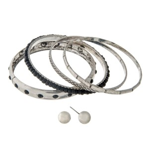 Burnished silver tone bangle bracelet set with black beads and a pair of matching stud earrings.