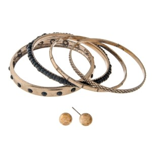Burnished gold tone bangle bracelet set with black beads and a pair of matching stud earrings.