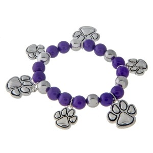 Purple beaded stretch charm bracelet with silver tone paw print charms.