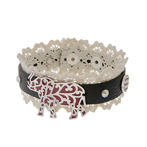 "Black faux leather cuff bracelet displaying ivory lace with a silver tone elephant and two houndstooth charms. Approximately 8 1/4"" in length."