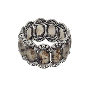 Burnished silver tone stretch bracelet displaying brown oval shaped stones with clear and gray rhinestone accents.