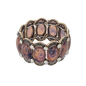 Burnished gold tone stretch bracelet displaying orange oval shaped stones with black diamond and white opal rhinestone accents.