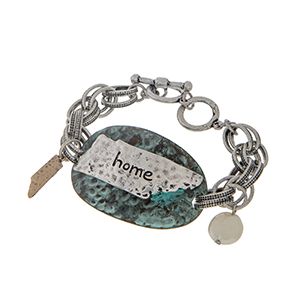 "Burnished silver tone toggle bracelet displaying a patina disk with a burnished silver tone state of Tennessee stamped ""home"". Approximately 7 1/2"" in length."