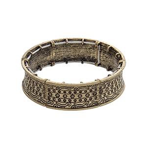 Burnished gold tone flower engraved stretch bracelet.