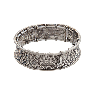 Burnished silver tone flower engraved stretch bracelet.