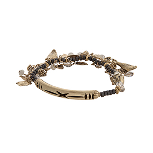 Ivory and gray beaded stretch bracelet with dangling burnished gold tone leaves.