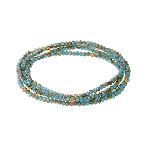 Multiple strand turquoise beaded stretch bracelet with gold tone bead accents.