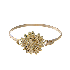Gold tone latch bangle bracelet with a sunflower focal.