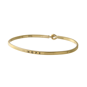 "Gold tone latch bangle bracelet stamped ""HOPE""."