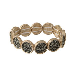 Gold tone stretch bracelet displaying disk with hematite chipstones.
