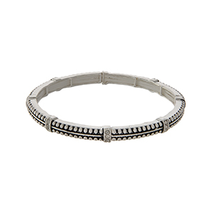 Silver tone stretch bracelet with rhinestone station accents.