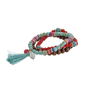 Triple strand stretch bracelet with brown wood, turquoise, and red beads, multicolored disk, and a turquoise tassel.