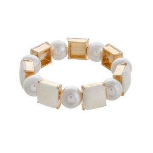Faux ivory pearl stretch bracelet with square cabochons.