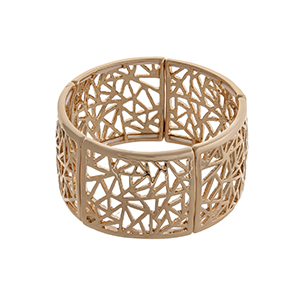 Gold tone stretch bracelet with triangular cutouts.