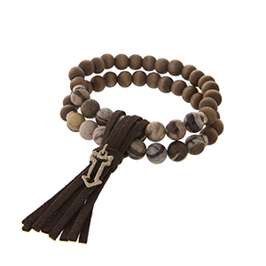 Two strand tiger stone and brown wood bead stretch bracelet with a brown fabric tassel and gold tone arrow charm.