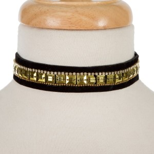 "Black fabric choker with gold tone squares and rhinestone accents. Can also be worn as a wrap bracelet. Approximately 15 1/2"" in length."