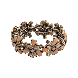 Burnished gold tone stretch bracelet with peach flower cabochons.