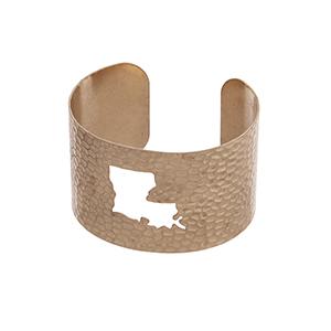 Gold tone hammered Louisiana state cuff bracelet.