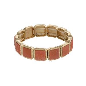 Gold tone square stretch bracelet with peach stones.