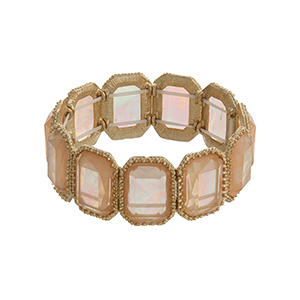 Gold tone rectangular stretch bracelet with peach iridescent cabochons.