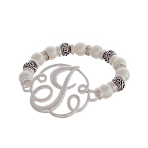"""Silver tone and pearl beaded stretch bracelet featuring the letter """"J"""" initial and accented with clear rhinestones."""