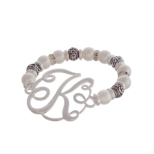 "Silver tone and pearl beaded stretch bracelet featuring the letter ""K"" initial and accented with clear rhinestones."