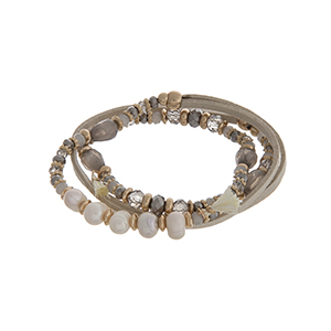 Ivory cord stretch bracelet with freshwater pearls and gray beads.