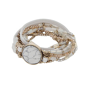 White wrap bracelet with gold tone hardware, ivory leather, and a howlite stone.