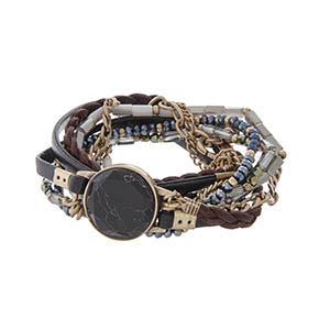 Wrap bracelet with gold tone hardware, black leather, and a black stone.