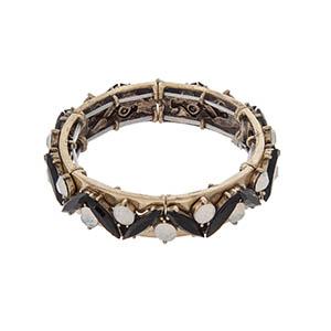 Burnished gold tone stretch bracelet with black stones and white opal rhinestones.