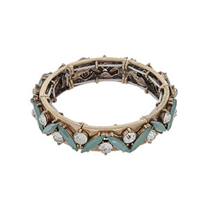 Burnished gold tone stretch bracelet with mint green stones and clear rhinestones.