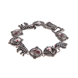 "Worn silver tone bracelet featuring houndstooth elephants and red rhinestones. Approximately 8"" in length."