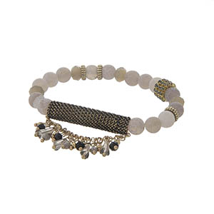 Gray beaded stretch bracelet with beaded fringe.