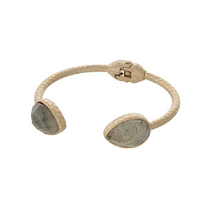 Hammered gold tone cuff bracelet with teardrop gray stones.