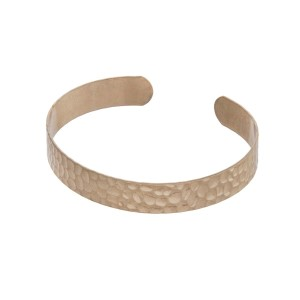 Gold tone hammered open cuff bracelet.