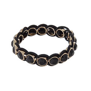 Stretch bracelet with black stones and gold tone hardware.