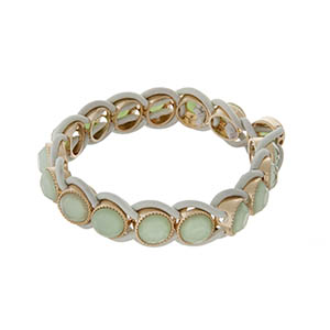 Stretch bracelet with mint green stones and gold tone hardware.
