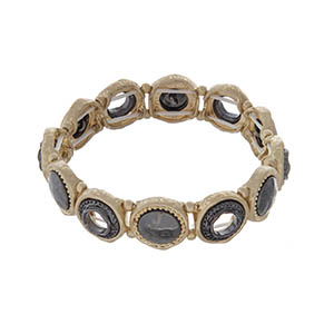 Gold tone stretch bracelet with hematite accents.