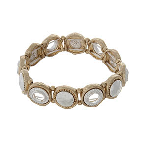 Gold tone stretch bracelet with silver tone accents.