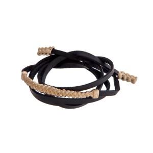 Black faux leather cord wrap bracelet with a braided gold tone bar and magnetic closure.