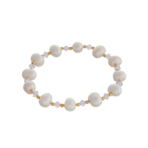 Freshwater pearl stretch bracelet with white opal and gold tone bead accents.