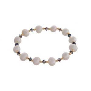 Freshwater pearl stretch bracelet with iridescent and gold tone bead accents.