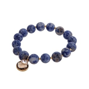 Navy blue natural stone beaded stretch bracelet with a faceted gray circle charm.