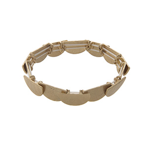 Worn gold tone stretch bracelet featuring layered half circles.