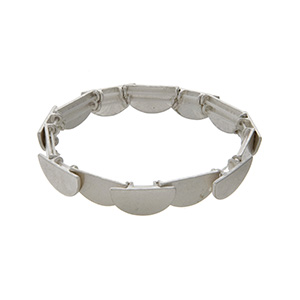 Worn silver tone stretch bracelet featuring layered half circles.