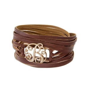 "Brown faux leather wrap bracelet with a gold tone 'B' initial focal. Approximately 22"" in length."