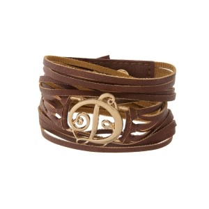 "Brown faux leather wrap bracelet with a gold tone 'D' initial focal. Approximately 22"" in length."