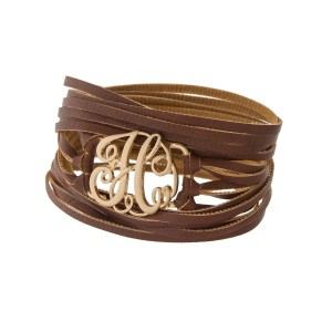"Brown faux leather wrap bracelet with a gold tone 'H' initial focal. Approximately 22"" in length."