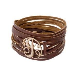 "Brown faux leather wrap bracelet with a gold tone 'J' initial focal. Approximately 22"" in length."