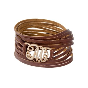 "Brown faux leather wrap bracelet with a gold tone 'M' initial focal. Approximately 22"" in length."